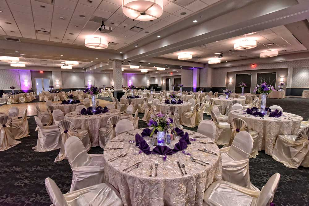 Beautiful Purple Centerpieces and full White linens at the Red Oak Ballroom B in San Antonio