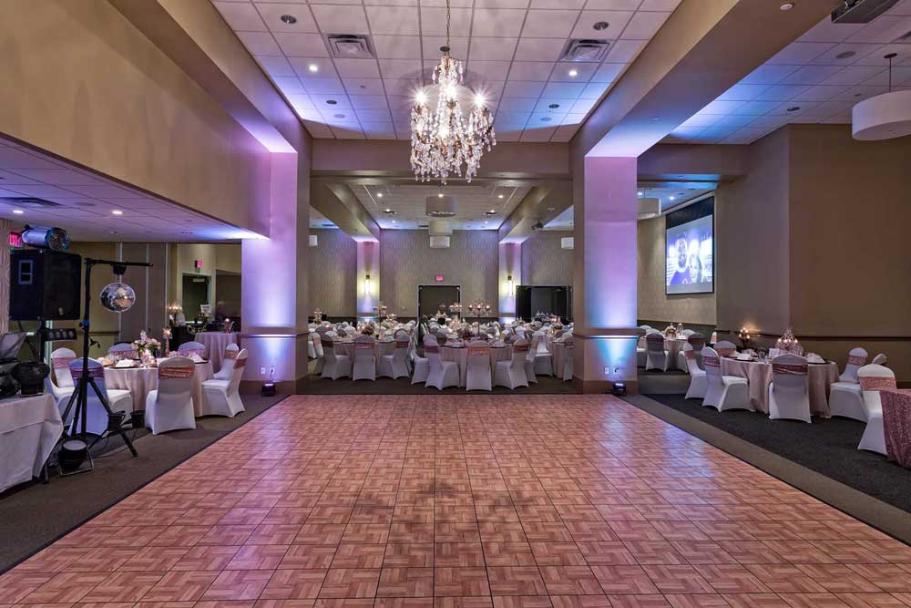 Red Oak Ballroom B in FtWorth with dance floor, chair covers and special chandelier