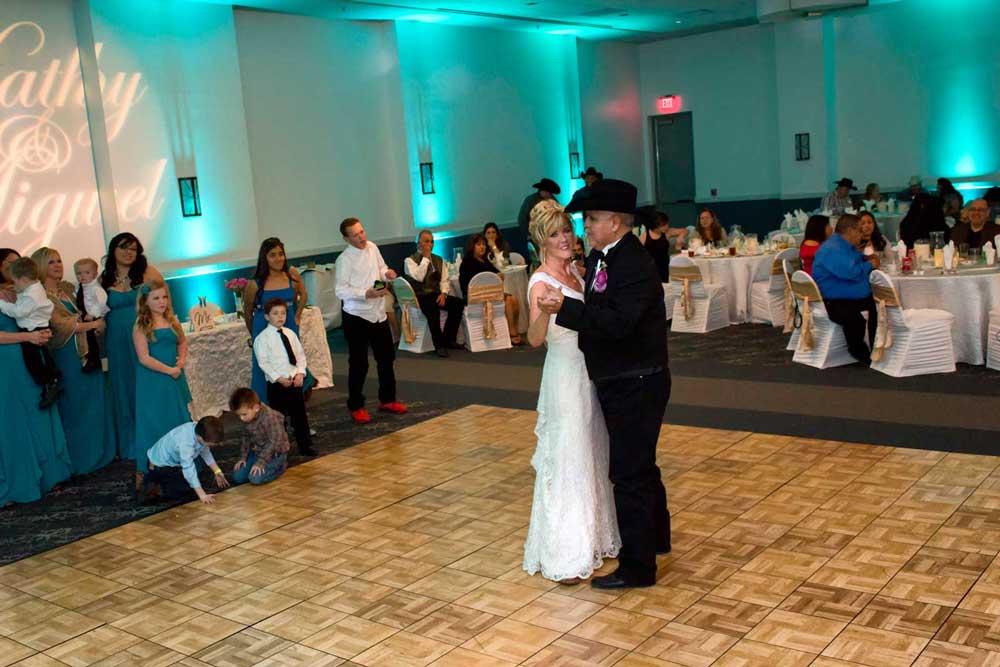 Happy Wedding Couple dancing at the Red Oak Ballroom A in San Antonio