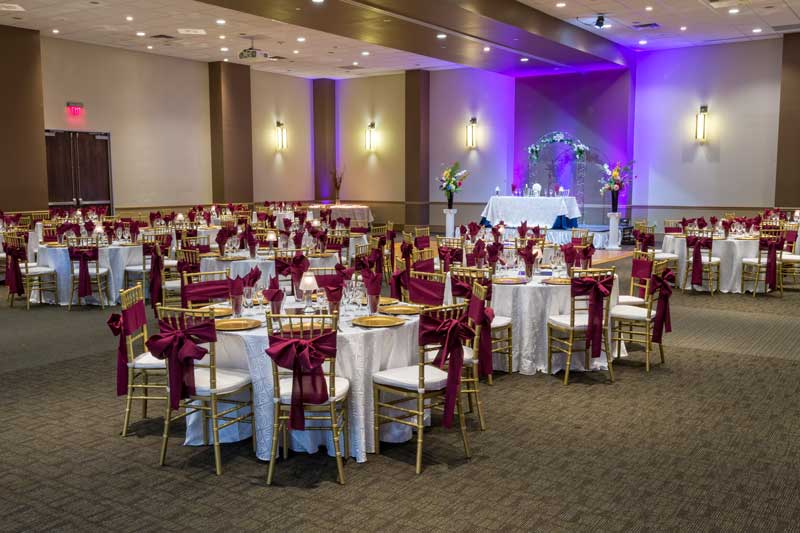 Red Oak Ballroom, Austin, chivari chairs, chair ties, table cloth overlays, gold chargers