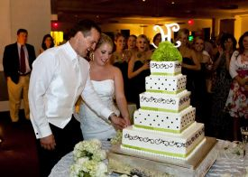 Bride and Groom Cutting the Cake at the Red Oak Ballroom in Houston, CityCentre