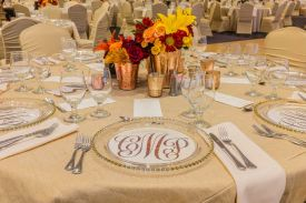 Elegant Wedding Reception Room Setup with covered guest chairs and specialty table linens at the Red Oak Ballroom in Houston, CityCentre