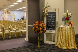 Elegant Wedding Ceremony Room Setup with perimeter pipe and drape and bamboo guest chairs at the Red Oak Ballroom in Houston, CityCentre