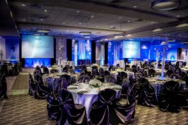 Dramatic Black and Blue Holiday Party setup with dramatic uplighting at the Red Oak Ballroom in Houston, CityCentre