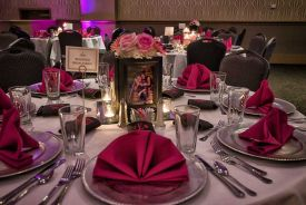 Red and Silver room setup with Silver Plate Chargers for a Wedding at the Red Oak Ballroom B in Fort Worth, Sundance Square