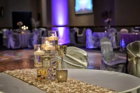 Dazzling Glass Candleholders and Textured Table Runner Decor at the Red Oak Ballroom B in Fort Worth, Sundance Square