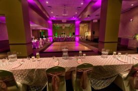 Dramatic Hot Pink and Green lighting with Pink and Ivory Linens for a Wedding at the Red Oak Ballroom B in Fort Worth, Sundance Square