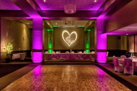 Dramatic Hot Pink and Green lighting with Custom Gobo for a Wedding at the Red Oak Ballroom B in Fort Worth, Sundance Square