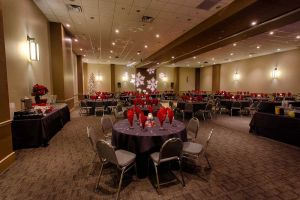 Elegant black and red Holiday Party set with Snowflake Gobo Light at Red Oak Ballroom Austin