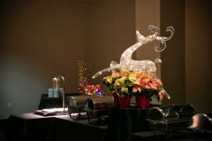 Fanciful Holiday Party buffet decorations on food table, including a carving station
