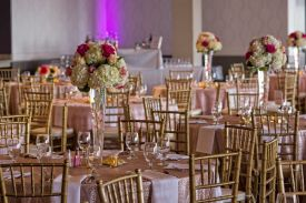 Elegant Wedding Reception Setup with Specialty Table Overlays and bamboo guest chairs at the Red Oak Ballroom in Houston, CityCentre