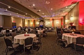 Fun, colorful Holiday Party set, with snowflake gobo and uplighting, Red Oak Ballroom in Austin