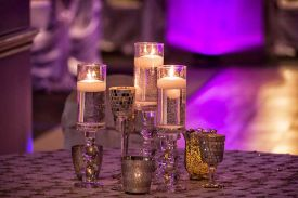 Special Glass Candle Decor with textured table linens for a Wedding Reception at the Red Oak Ballroom B in Fort Worth, Sundance Square
