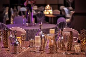 Elegant Gold, Silver and Copper Glass Decor with textured table linens for a Wedding Reception at the Red Oak Ballroom B in Fort Worth, Sundance Square
