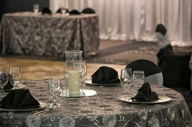 Stately Black and Gray table linens with plate chargers for a Special Celebration