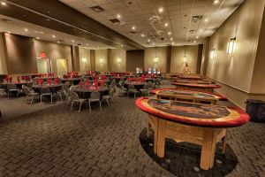 Festive black and red Holiday Party set with Casino tables at Red Oak Ballroom Austin
