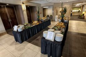 Festive Double Food Buffet setup in Austin Lobby for a Red Oak Ballroom Holiday Party