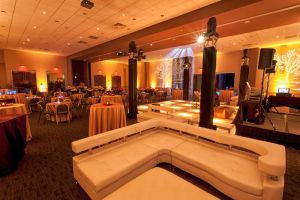 Massive, custom Company Holiday Party set with Specialty lighting and table decorations at Red Oak Ballroom Austin