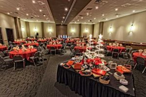 Festive black and red Holiday Party set with Specialty Dessert Display table at Red Oak Ballroom Austin