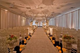 Gorgeous Wedding Ceremony Room Setup with perimeter pipe and drape at the Red Oak Ballroom in Houston, CityCentre